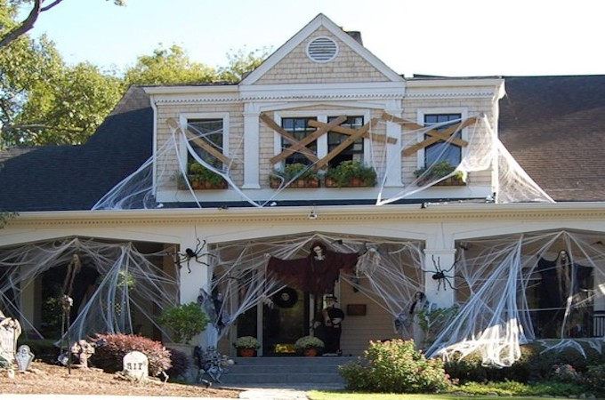 cute-outdoor-halloween-decorations-wooden-siding-gray-roof-exterior-decor